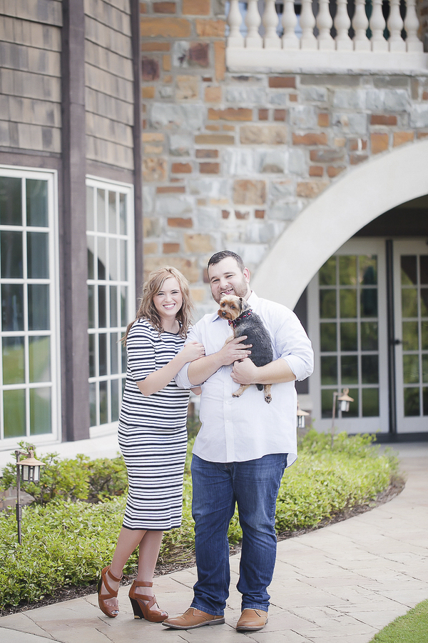 couple with Yorkie at country club, engagement pictures with dog