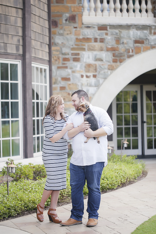 woman in striped dress, man holding Yorkie, engagement photos at country club