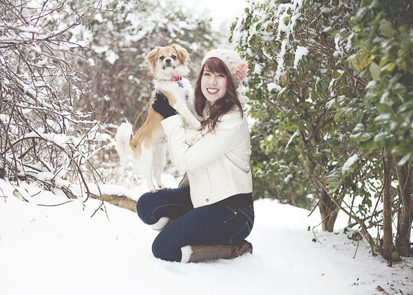 Woman holding small dog, snow day in NC,