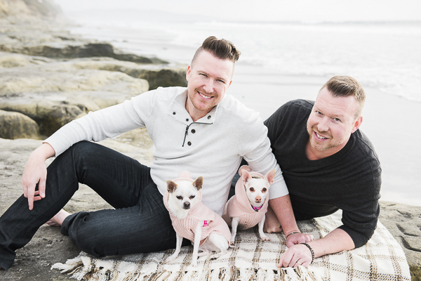 Adorable white Chihuahuas in pink coats with their dads, Del Mar Beach, modern dog photography