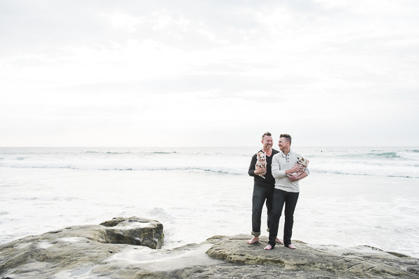 guys holding Chihuahuas on rock, Del Mar Beach, family portraits with dogs