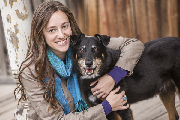young woman hugging happy dog, sunset session dog photography