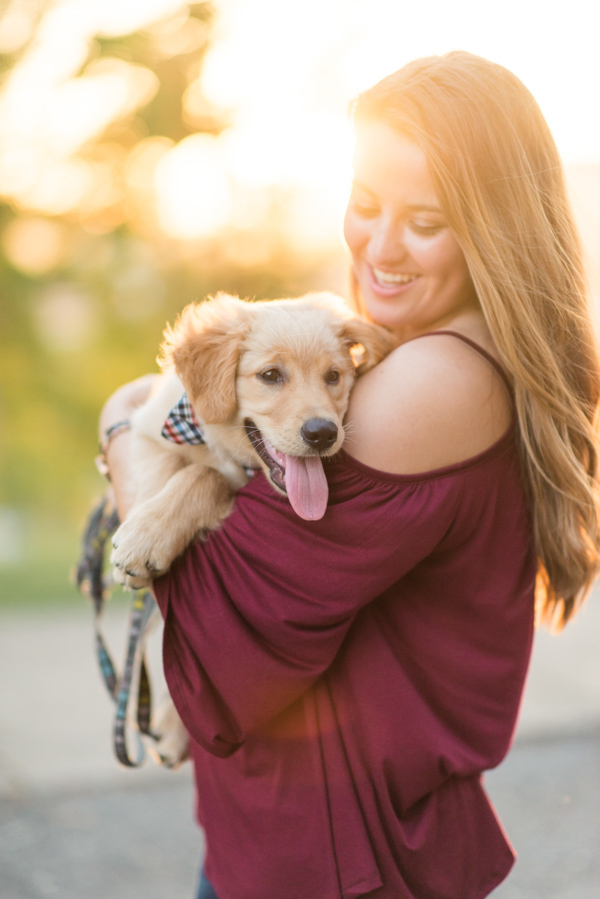 woman holding Golden Retriever puppy