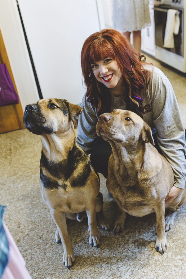 Shar pei mix dogs and bride to be on wedding day, getting ready