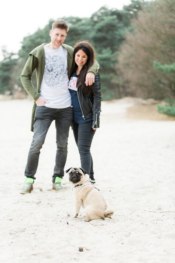 Pug and couple on beach, fine art dog photographer