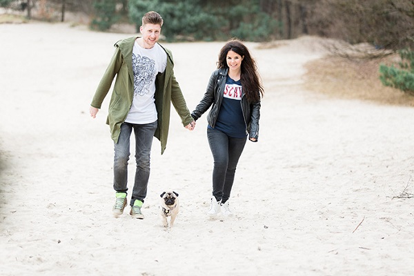 couple walking with Pug on beach, lifestyle dog photographer