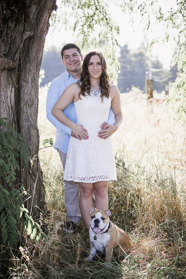 man in blue shirt, woman in white dress, English Bulldog, happy engagement photos with dog