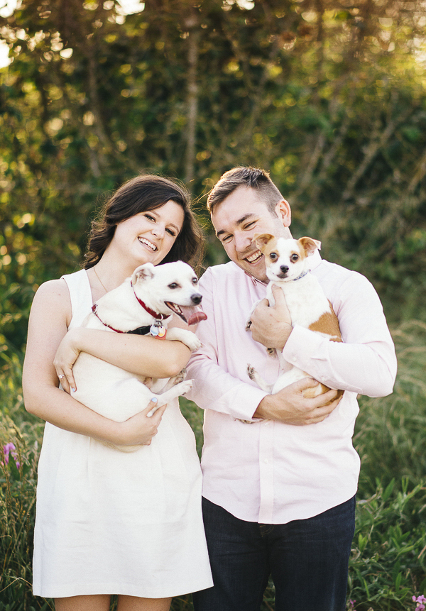 happy couple holding terrier mix, Chi mix, PNW engagement photos with dogs