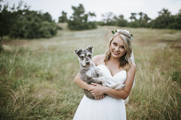 bride holding Schnauzer mix