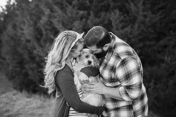 couple kissing dog, engagement photos with dog