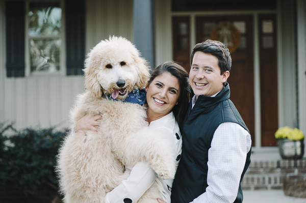 family photos with dog, woman holding Golden Doodle