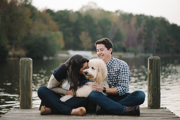 woman kissing dog on dock, lifestyle dog photography