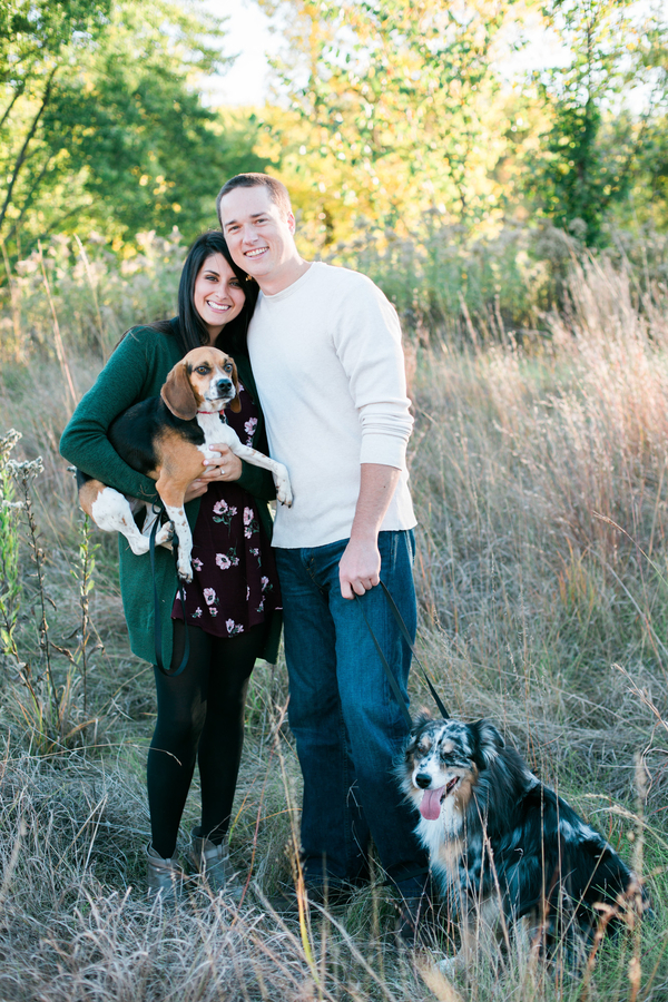 woman holding beagle, man holding Australian Shepherd's leash, MN engagement photos