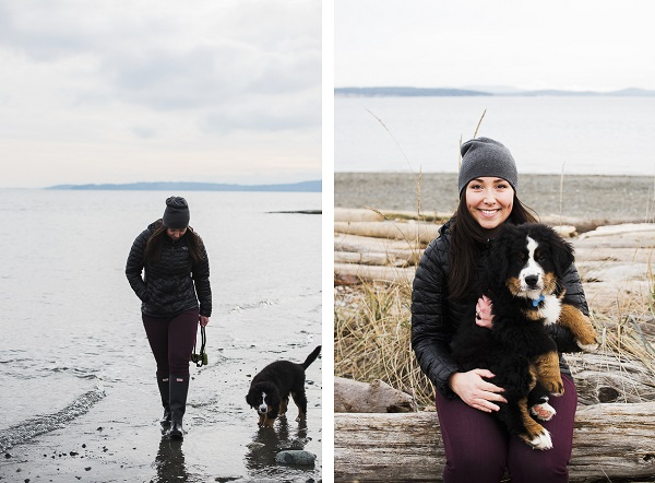 woman walking puppy on beach, holding puppy, winter beach dog pictures
