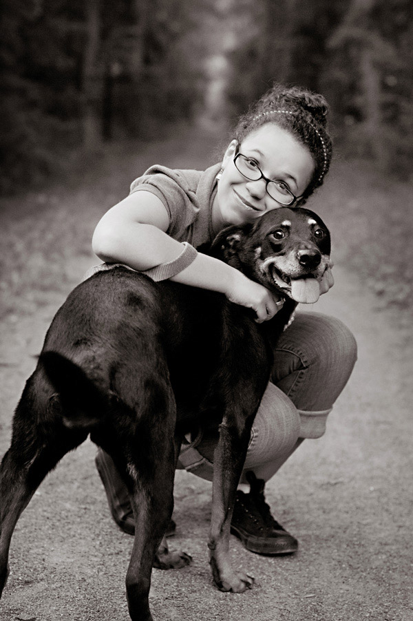 high school senior hugging dog
