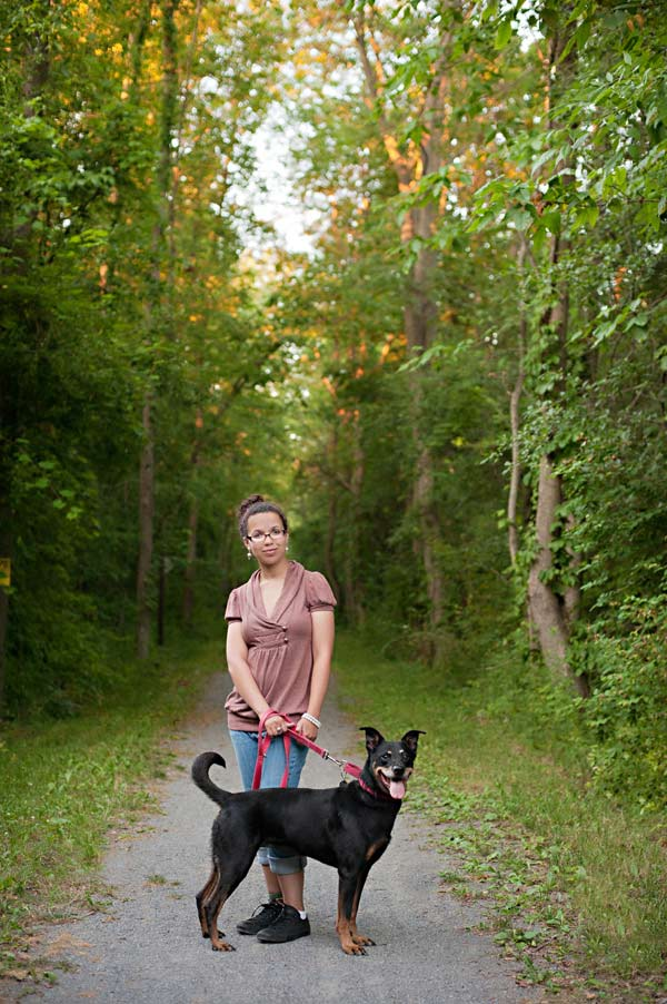 senior portrait with dog, girl and dog on trail