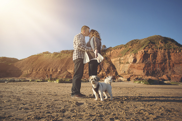 small dog, engaged couple, Jurassic Coast