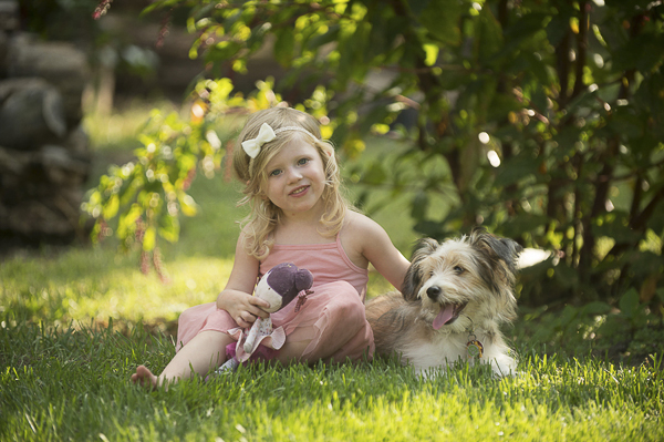 little girl and her dog sitting in front of bush, girl and her dog, bffs