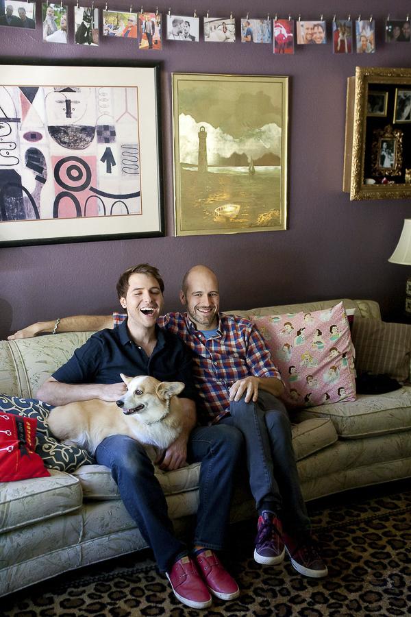 Corgi and her humans, 2 men sitting with dog on sofa, lifestyle dog photography, same sex engagement photos