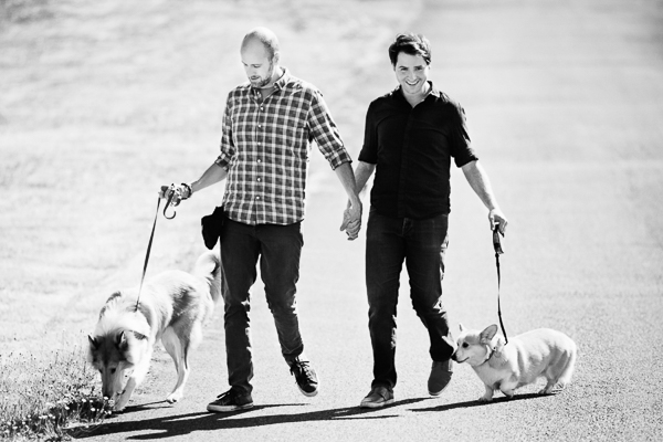 engagement session with dogs, men holding hands while walking dogs