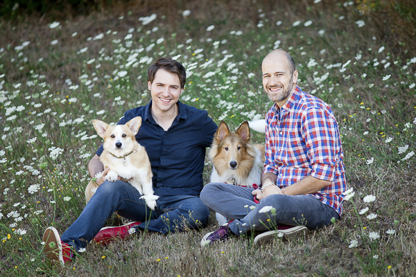 family portrait, Corgi, Collie, engaged couple sitting in flowers