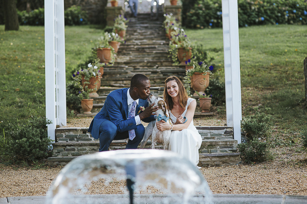groom kissing dog, just married couple and their mixed breed