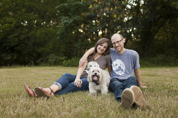 small mixed breed standing in between couple with matching ts, creative dog portraits