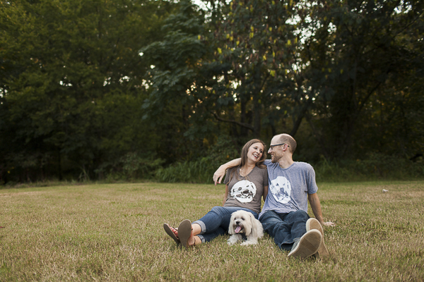 couple and Shih Tzu mix sitting on grass, engagement pictures with dogs