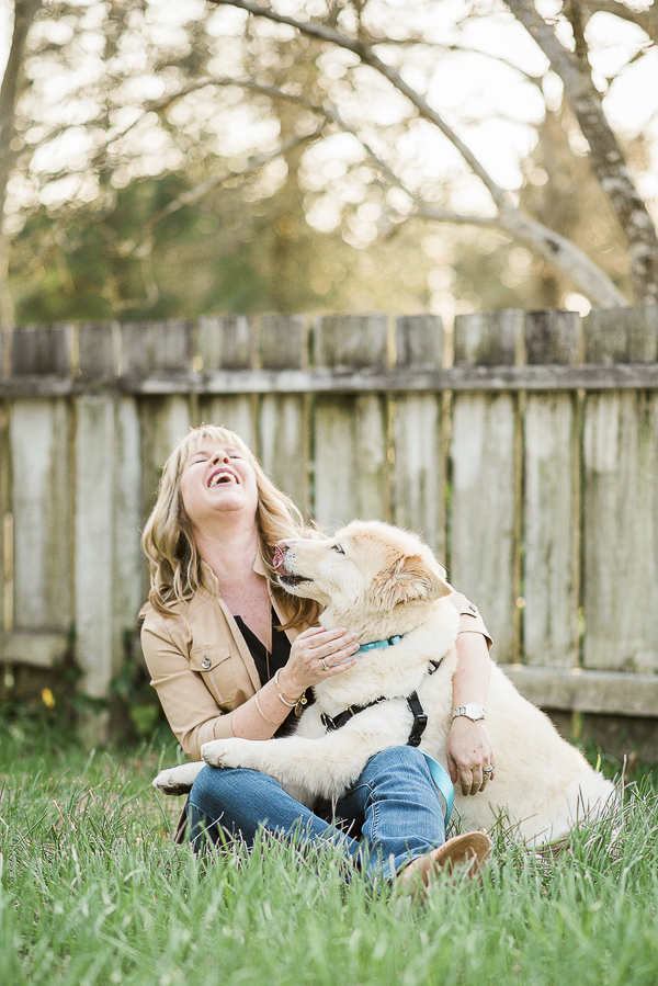 woman and dog laughing, love between human and dog