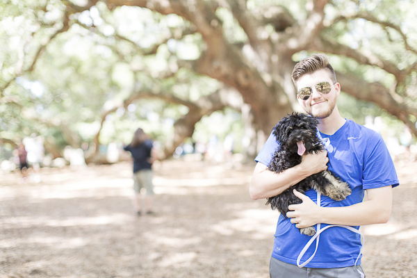 man holding puppy in front of big live oak tree, Charleston, SC
