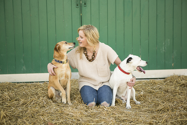 woman with arms around her dogs, love between dogs and humans