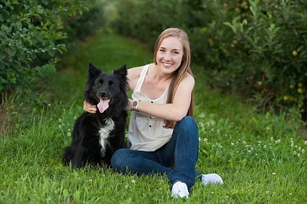 high school senior, black dog in apple orchard