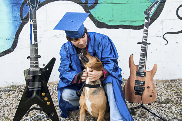 high school senior with dog and guitars.