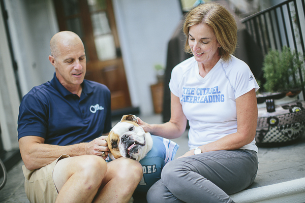 English Bulldog enjoying scratches, family photos with English Bulldog