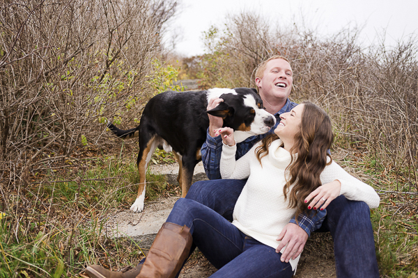Swiss Mountain Dog licking woman's face, engagement pictures with dogs