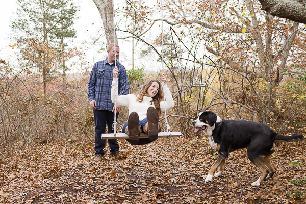 including dog in engagement photos, woman on wood swing in the woods
