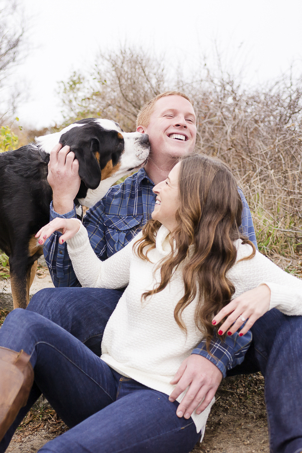 man laughing as big dog licks his cheek, engagement photos with a dog