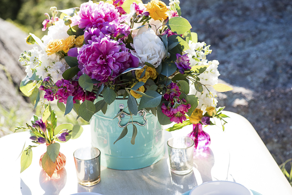 wedding flowers arrangement in aqua dog food container