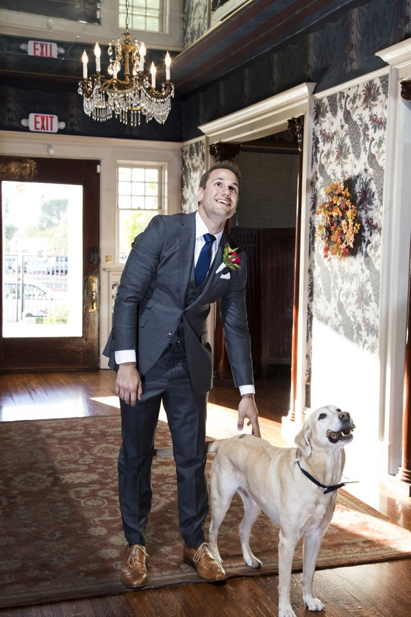 groom and dog looking up at bride, first look with dog