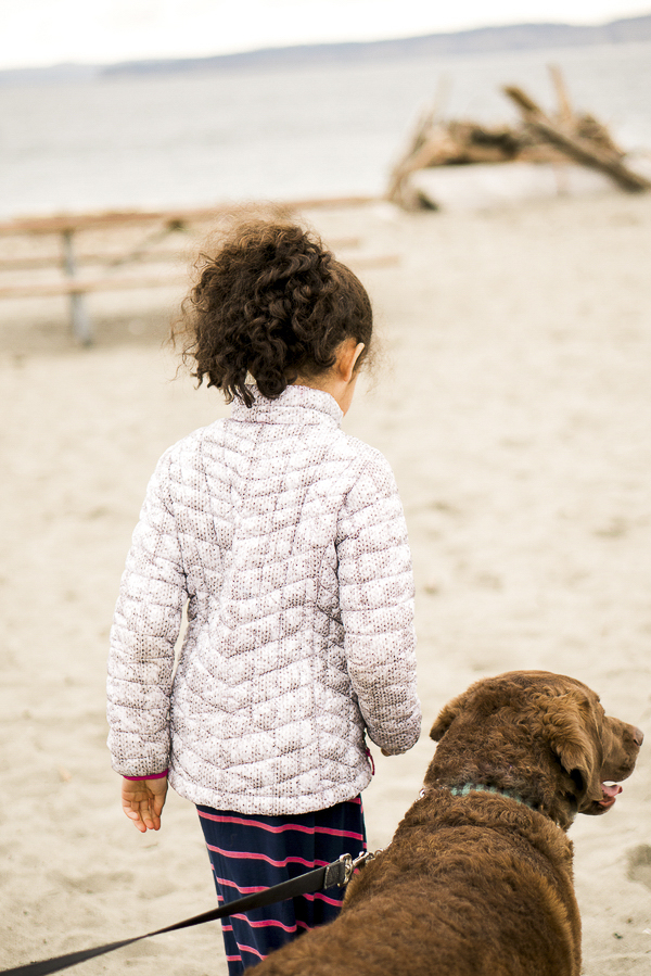 girl and her dog on beach