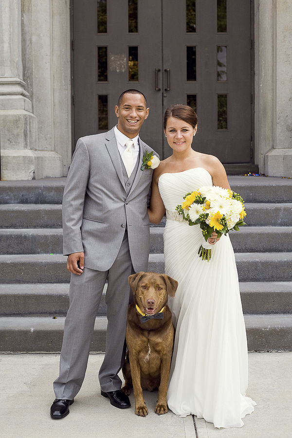 happy couple with dog, groom, bride, dog in front of church steps