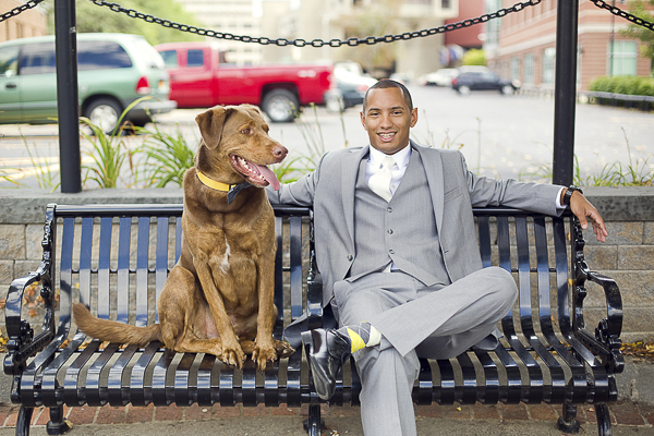 dog and groom sitting on bench, man's best friend