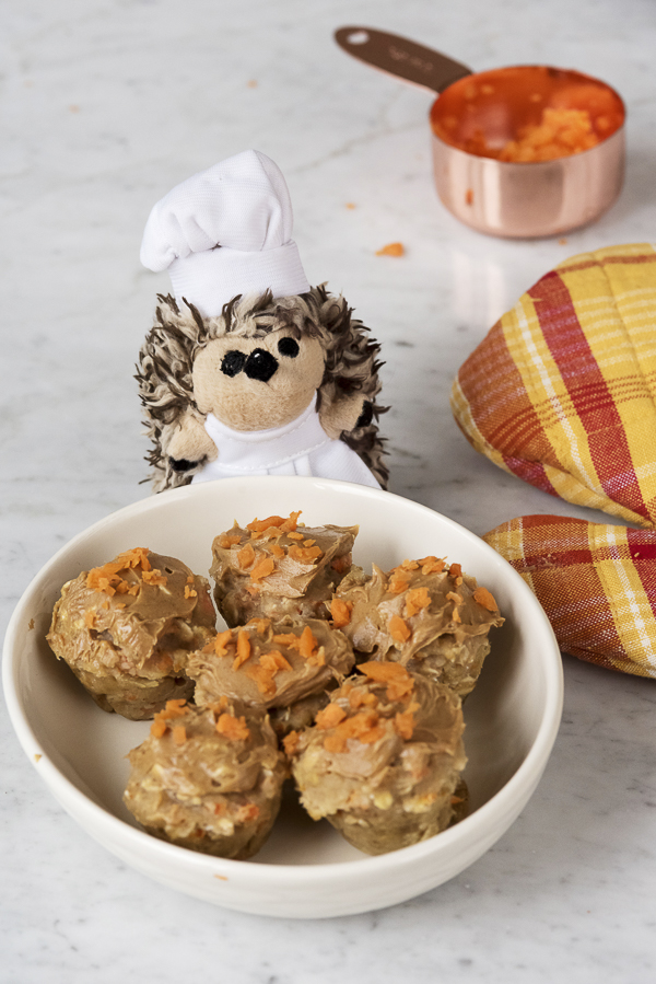 stuffed toy hedgie in chef's hat, dog pupcakes, vegan dog treats