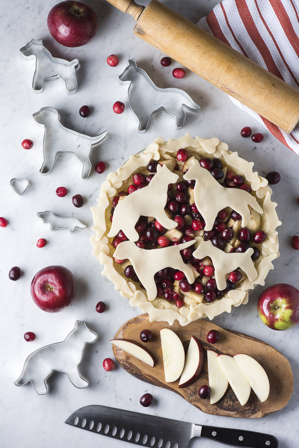 dog themed pies, flatlay, pie crust cookie cutters, apples, cranberry