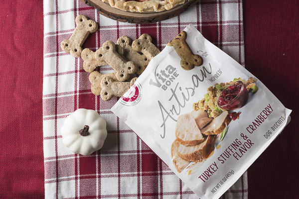 Vita Bone Dog Treats, turkey stuffing and cranberry flavor on red plaid runner