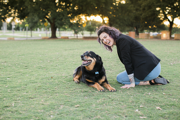 dog smiling, woman laughing at park, devoted human-dog relationship