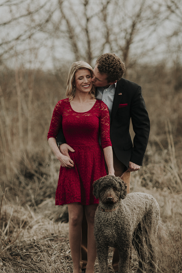 Labradoodle, winter engagement photos, woman in red dress, dog