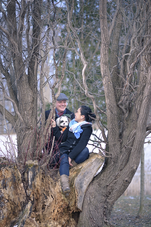 couple in trees with small dog