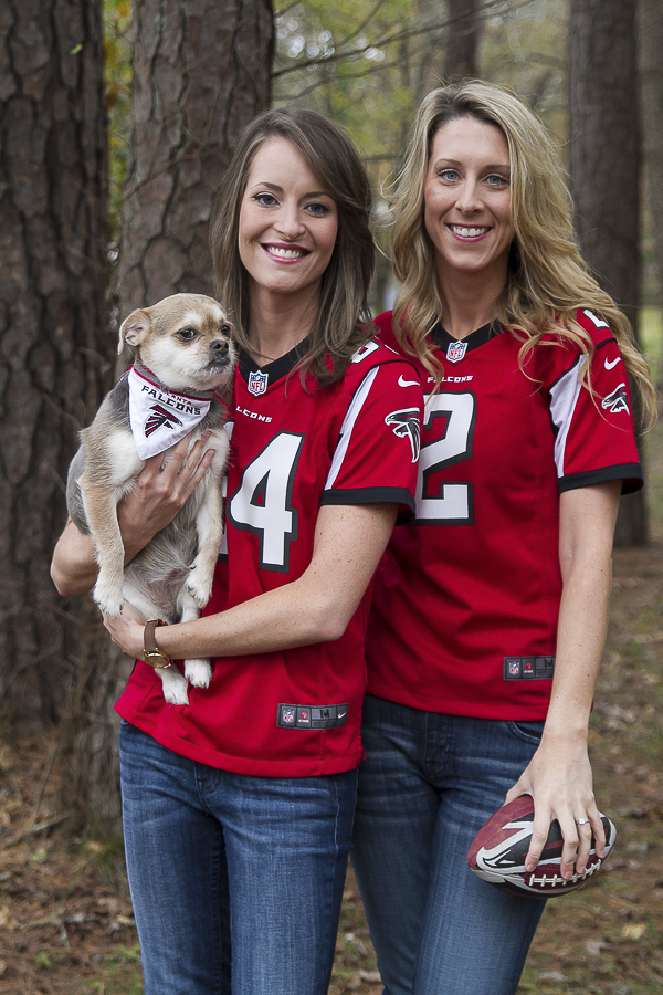 women wearing Falcon jerseys, dog wearing Falcon bandana, engagement pictures with dog