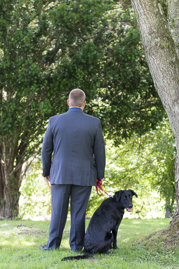 groom and black lab mix waiting for bride, First Look Photos with dogs